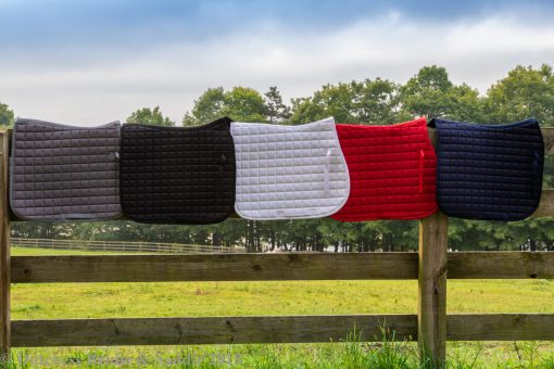 Horze Bristol AP saddle pads in gray, black, white, red, and peacock navy blue