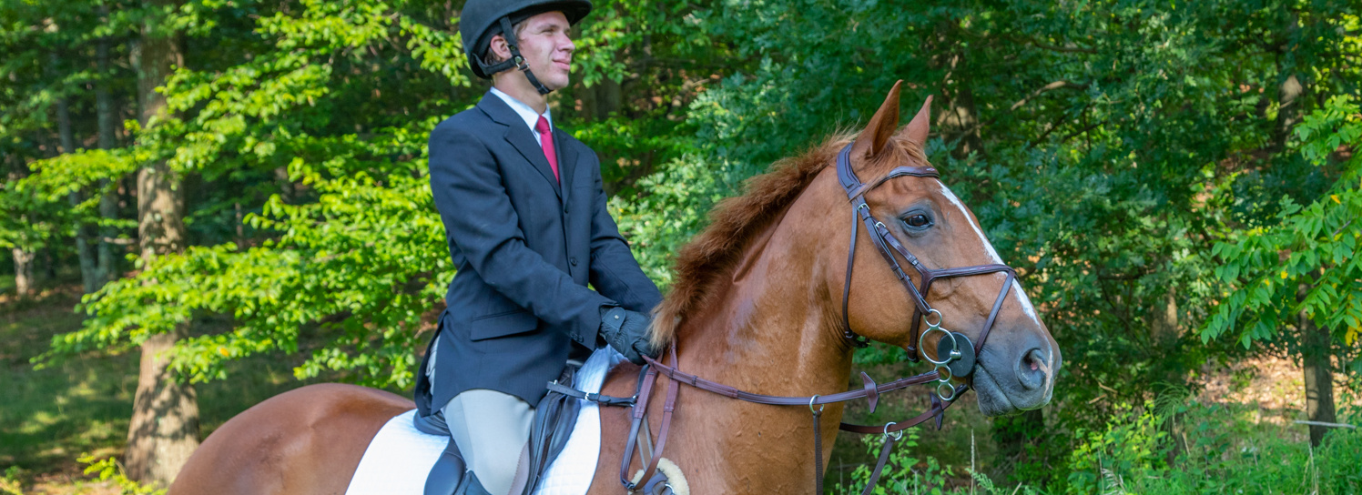 Kent & Masters S-Series jump saddle with chestnut horse and rider